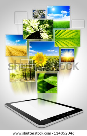 one computer tablet with photo collage of nature, isolated on white background - stock photo