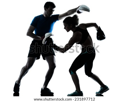 one  couple man woman personal trainer coach man woman boxing training silhouette studio isolated on white background - stock photo