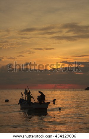 one couple will sail for fishing at dawn ; southern of Thailand