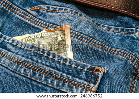 One crumpled dollar in your pocket jeans. Crisis, poverty concept. The collapse of the world economy concept - stock photo