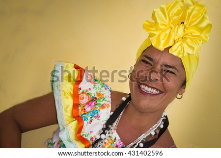 One cuban woman with traditional clothing and headdress - stock photo