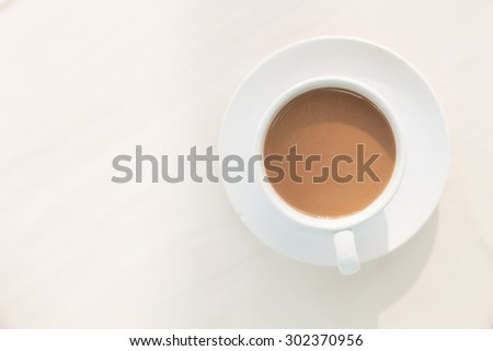 One cup of coffee. White coffee drink in the morning. - stock photo