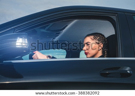 One cute girl driving car. - stock photo