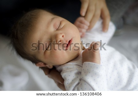 One day newborn in hospital bedroom. Low key, window light, - stock photo
