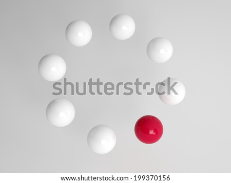 One different red ball in a circle of white balls at an oblique angle with perspective conceptual of diversity, individuality and leadership - stock photo