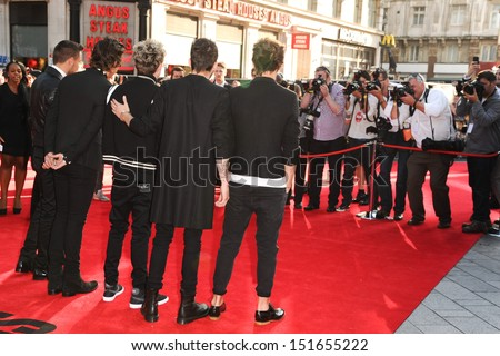 "One Direction arriving for the ""One Direction: This is Us"" World premiere at the Empire, Leicester Square, London. 20/08/2013 - stock photo"