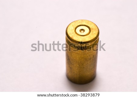 One Dirty 9 mm shell casing primer up - stock photo