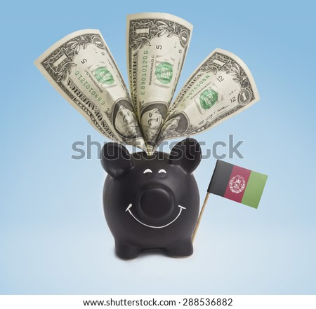 One dollar banknote in a smiling piggybank of Afghanistan.(series) - stock photo