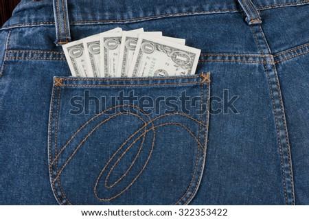 One dollar banknotes in denim jeans pocket - stock photo