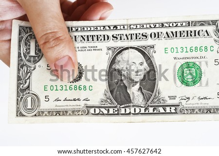 One dollar bills on hand isolated on white background