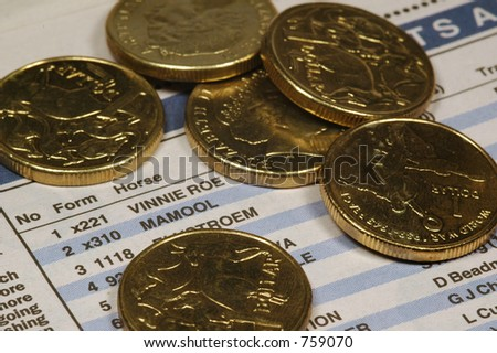 one dollar coins over newspaper - stock photo