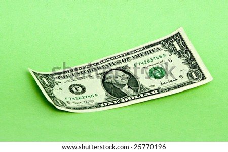 One dollar isolated on green background