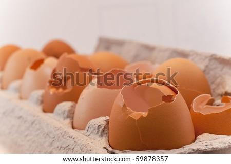 One dozen cracked eggs - stock photo