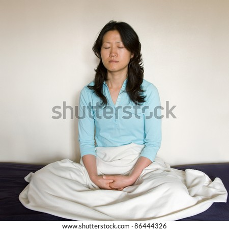 One East Asian woman seat in meditation