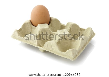 One egg in the package on white background - stock photo