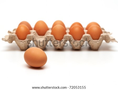One egg lie near the container - stock photo