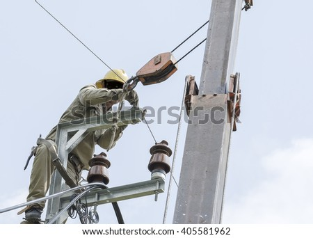 One electrician climbing on electric is repairing electrical power system for normal working. Closed-up view. - stock photo