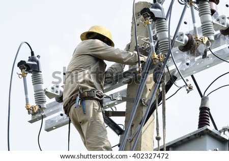 One Electrician repairing wire on electric power pole. - stock photo
