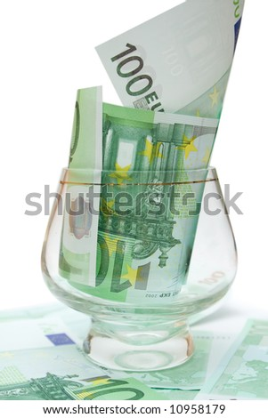 one 100 eur banknote in wineglass over white isolated background