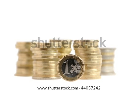 one euro and coins money piles over white