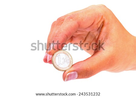 One euro coin in female hand - stock photo