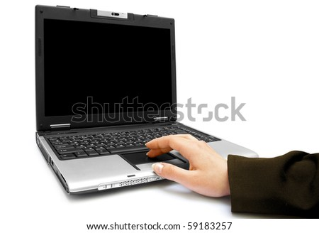 One female hand on the laptop isolated on white background - stock photo