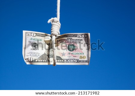 one fifty Dollar banknote hanging in the air at a  gibbet cord: Concept for Dollar crisis, financial benefit or trap    - stock photo