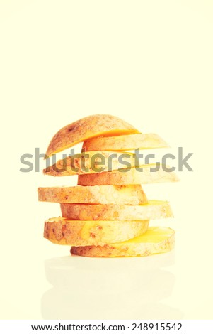 One fresh sliced potatoe in stack composition. - stock photo