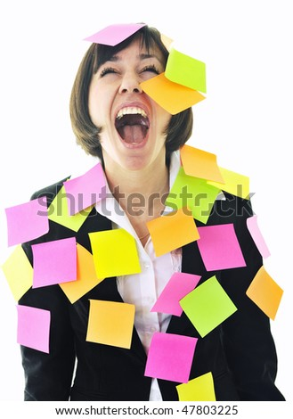one frustrated young business woman with many of post it representing concept memory and frustration on work - stock photo
