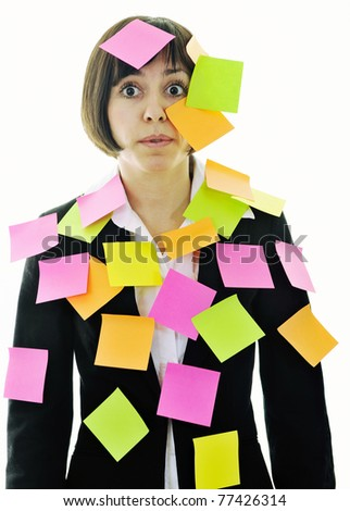 one frustrated young business woman with many of post representing concept memory and frustration on work - stock photo