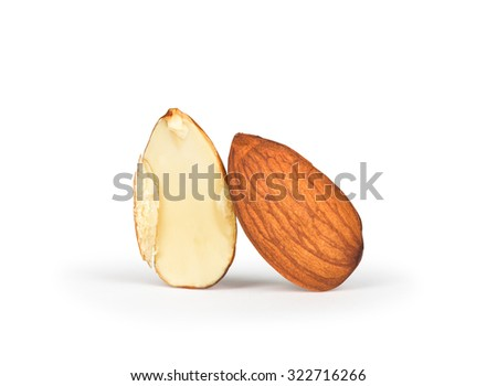 One full and half almonds isolated on white background