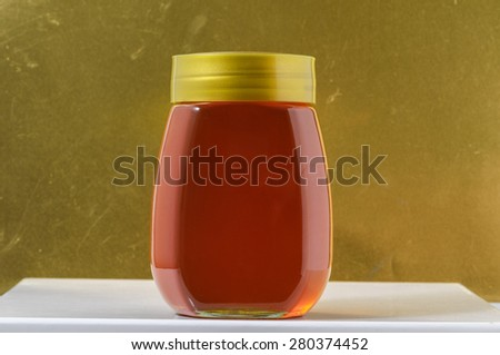 One Full Honey Jar on a Colored Background - stock photo