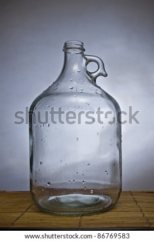 One gallon glass container for water or wine, closeup shot - stock photo