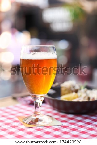 One glass of light beer with salad in the pub - stock photo