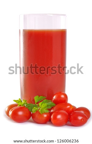 one glasses of healthy freshly blended tomato juice accompanied by whole tomatoes isolated on white - stock photo