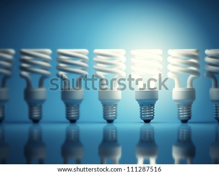 One glowing light bulb among many of the disabled - stock photo