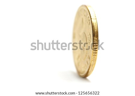 one gold coin standing - stock photo
