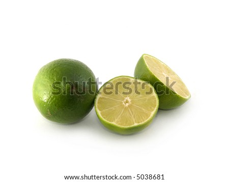 One green lime and two halves on the white background - stock photo