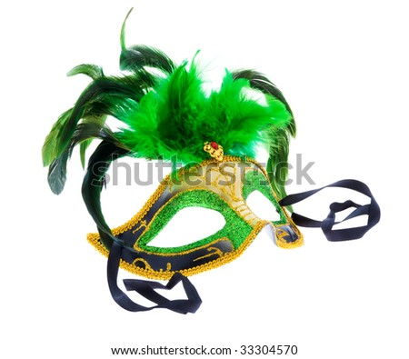one green venetian mask with feather isolated on white - stock photo