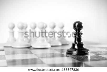 One group oppressed by single strong bully. - stock photo