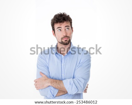 one guy in blue shirt remembering something - stock photo