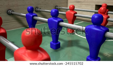 One half of a foosball table at ground level with a soccer ball in front of the red team ready to kick off a soccer match  - stock photo