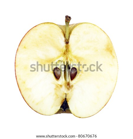 One half of an apple showing its seeds at the core, isolated against white. - stock photo