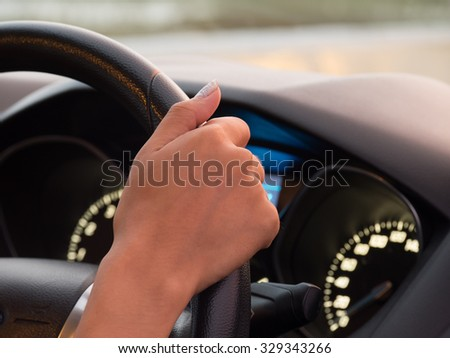 One hand driving car showing meters - stock photo