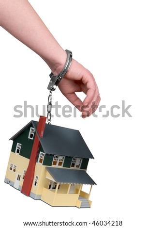 One hand handcuffed to a house isolated over white - stock photo