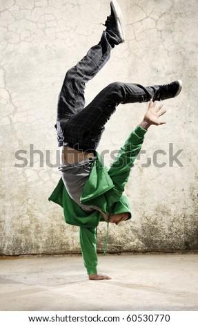 One hand handstand hip hop dancer - stock photo