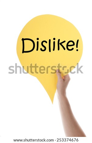 One Hand Holding A Yellow Speech Balloon Or Speech Bubble With English Text Dislike Isolated On White - stock photo