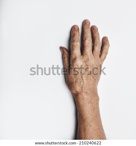 One hand of an elderly woman isolated on white background. Senior lady wrinkled hand with copyspace for your text. - stock photo