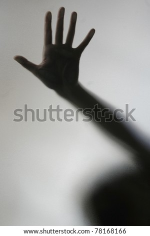 One hand pressed against a diffused screen - stock photo