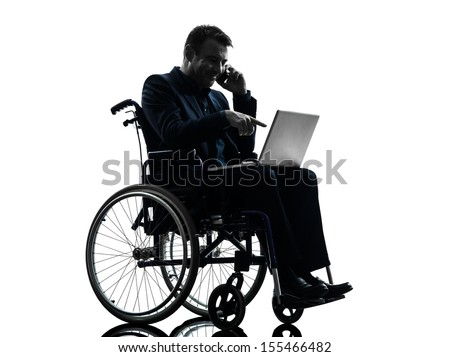 one handicapped business man computing laptop computer in silhouette studio  on white background - stock photo